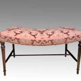 Georgian mahogany saddle seat stool.