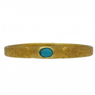 Medieval turquoise bishop's stirrup ring 'God gives me the joy of love', circa 14th century.