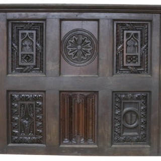 An Antique Carved Oak Wall Panel
