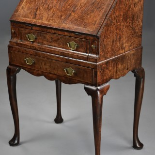 Extremely rare George I pollard oak bureau on stand of superb patina and of small proportions