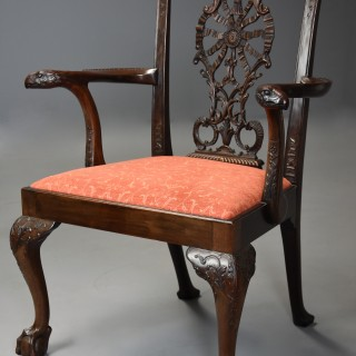 Superb quality early 20th century carved mahogany open armchair in the Chippendale style.