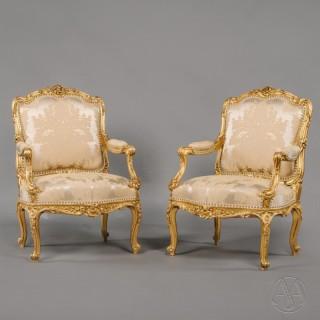 A Pair of Louis XV Style Carved Giltwood Fauteuils à la Reine