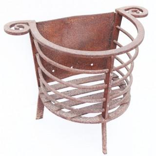 An Antique Wrought Iron Fire Basket