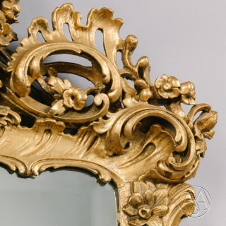 A Pair of George III Style Carved Giltwood Mirrors