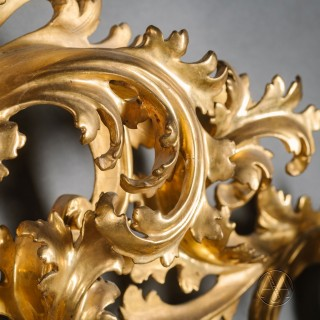 A Large and Elaborately Carved Florentine Giltwood Mirror