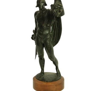 A BRONZE STATUE OF PERSEUS HOLDING THE HEAD OF MEDUSA