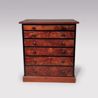 A 19th century mahogany collectors cabinet