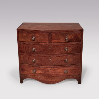 A 19th century miniature bow fronted chest of drawers