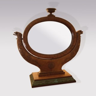 A 19th century French oval mahogany dressing mirror