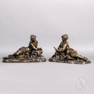 A Fine Pair of Patinated Bronze Figures of River Nymphs