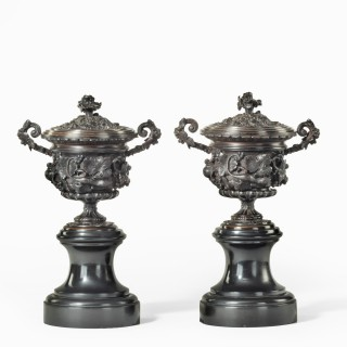 A pair of bronze vases and covers in the classical style