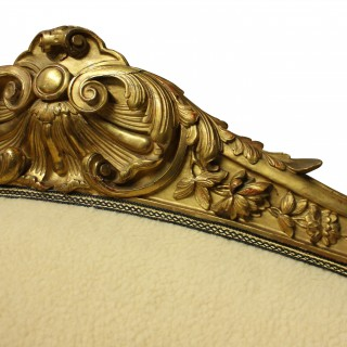 A LARGE ENGLISH EARLY XIX CENTURY GILTWOOD SETTEE