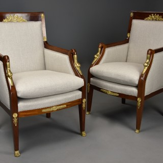 Pair of highly decorative early 20thc French mahogany upholstered armchairs in the Empire style