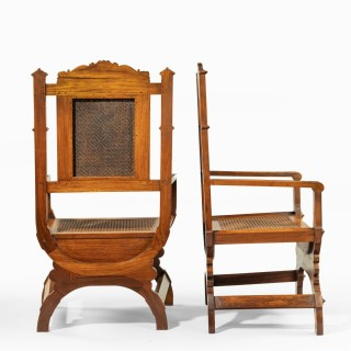 A pair of Indian throne chairs, carved with the arms of the Kingdom of Travancore
