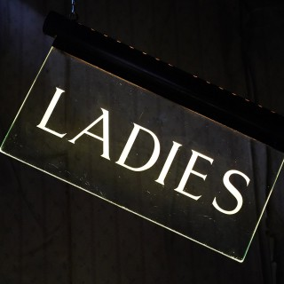 An Art Deco Illuminated Etched Glass Foyer Restroom Sign; Ladies; By Internalite c.1925-35