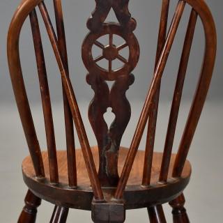 Rare & unusual early 19thc yew wood wheelback Windsor chair