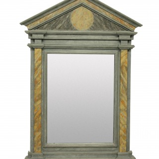 A MARBLED ROMAN STYLE MIRROR