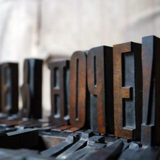 A 19thC Alphabet Tray of Wooden Letterpress Printing Blocks c.1895