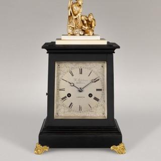 C. LUPTON. A RARE MID-19TH CENTURY MINIATURE EBONISED ENGLISH FOUR-GLASS CARRIAGE CLOCK.