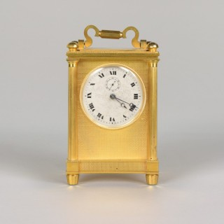 ENGLISH CARRIAGE CLOCK. AN UNUSUAL ENGLISH GILT ENGINE TURNED CARRIAGE TIMEPIECE