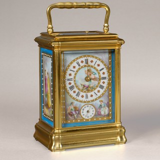 A FINE 'SEVRES' PORCELAIN PANELLED CARRIAGE CLOCK