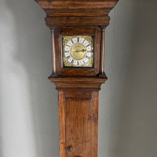 An Early Oak Clock with a 9 inch Movement circa 1700
