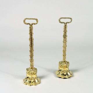A near pair of Brass hairy paw doorstops.