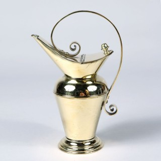 A brass Arts and Crafts watering can, by Benham and Froud, Design attributed to Christopher Dresser