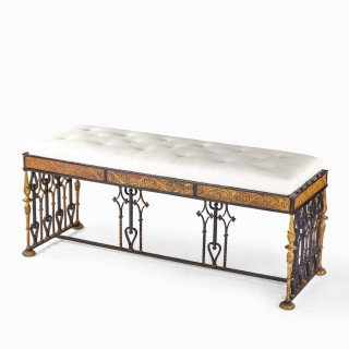 A long parcel gilt wrought iron stool attributed to Oscar Bach