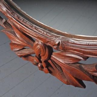 Carved Black Forest Walnut Wall Mirror
