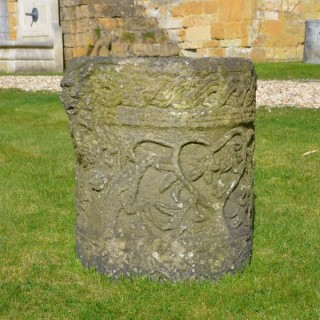 A Romanesque style carved stone planter