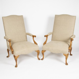 Carved beech high back armchairs upholstered in linen.