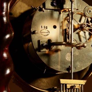 An original antique inlayed French portico clock circa:1870
