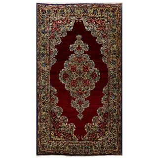 Antique red Persian rug from Kirman