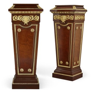 Pair of French Neoclassical style parcel gilt mahogany pedestals