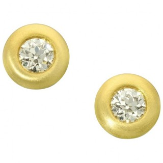 A beautiful pair of 22ct yellow gold and old cut diamond doughnut set earrings.