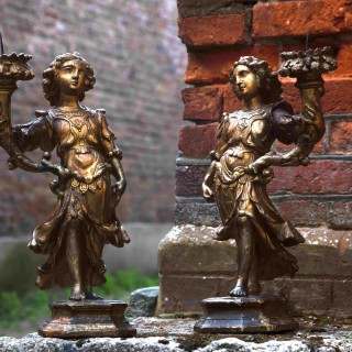 17th century Italian carved and giltwood figurative candlesticks