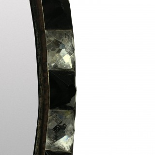A GEORGIAN STYLE IRISH MIRROR WITH BLACK GLASS & ROCK CRYSTAL FACETED BORDER