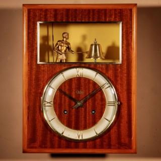 A French Mahogany And Satin Wood Signed Odo Automation Striking Wall Clock.