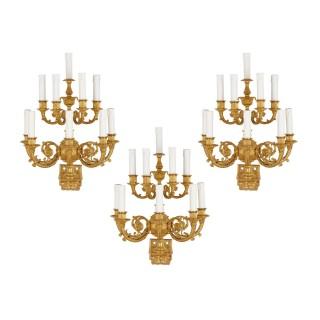 Set of three Neoclassical gilt bronze wall lights