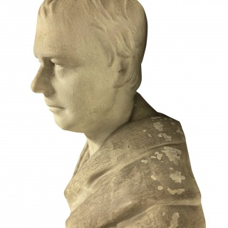 A CLASSICAL PLASTER LIBRARY BUST ON BRACKET
