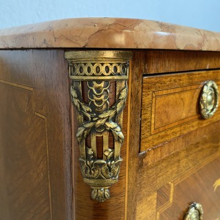 An early 20 th  century marble topped French gilt metal mounted commode of small proportions