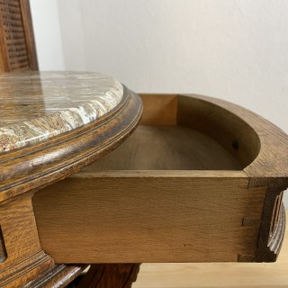 A French late 19th century oak hall stand with an arched top