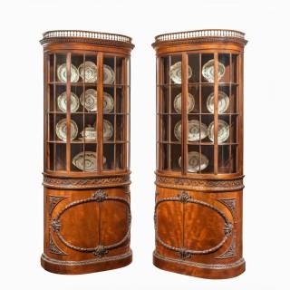 A pair of mahogany shaped display cabinets attributed to Gillows