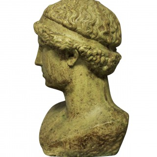 A LIFE SIZE GLAZED STONE HEAD OF A HELLENISTIC YOUTH