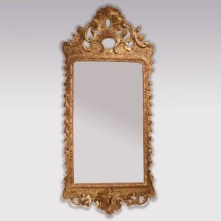 A George II period carved gesso mirror