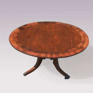 A Regency period mahogany and rosewood breakfast table