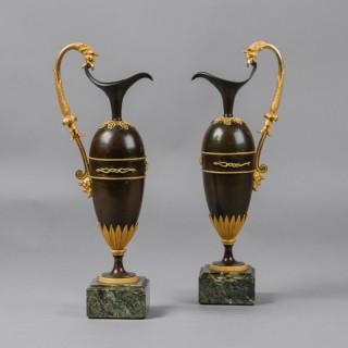 A Pair of Empire Bronze Ewers