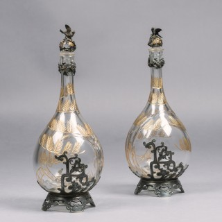A Pair of 'Japonaise' Style Silver Plated and Engraved Glass Decanters