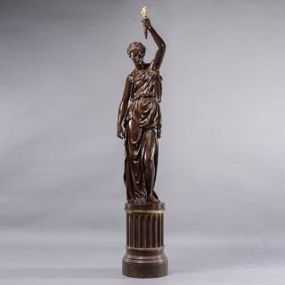 A Patinated Bronze Figural Torchère